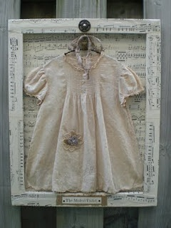 vintage baby dress framed using the BACK of a canvas. I have done this before making kind of a shadow box-so cool!