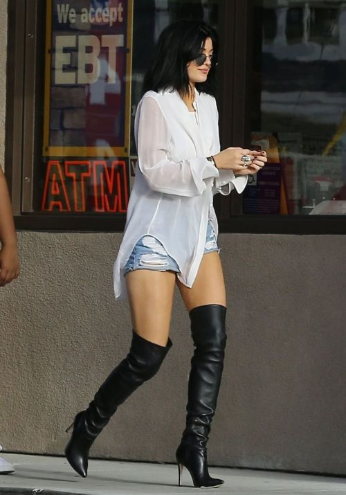 White or Black blouse. Light Wash shorts or skinny Jeans. Over the knee, high heel boots.