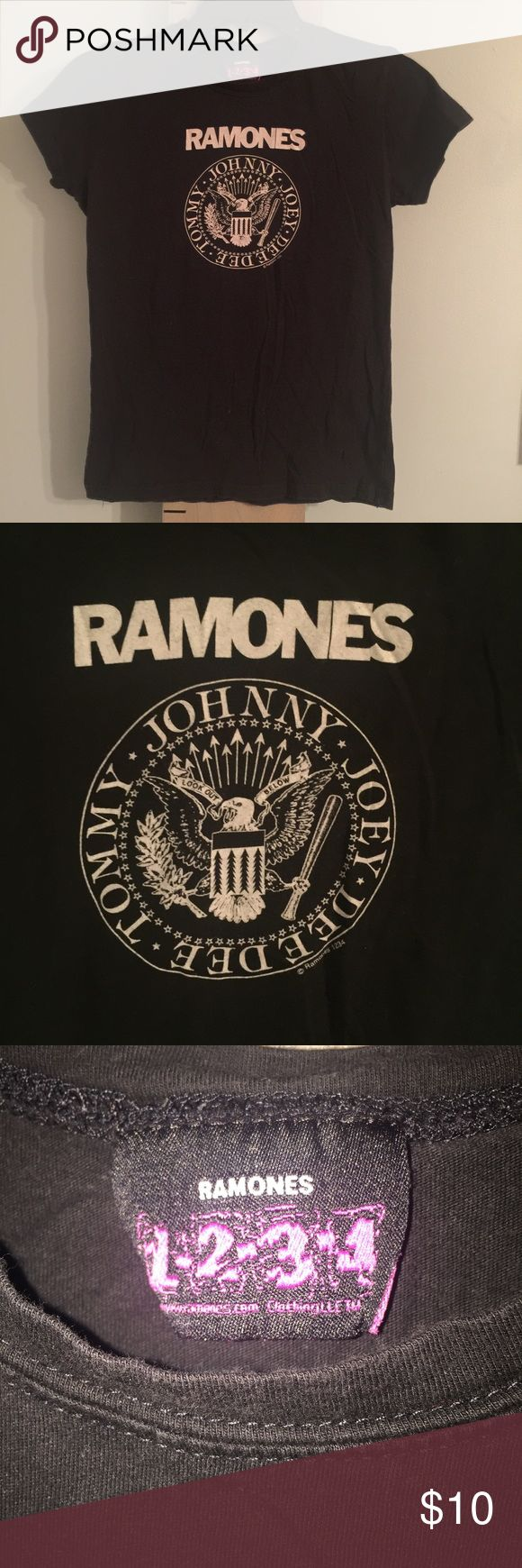 """Ramones Band Tee 100% Cotton Black White This shirt is so fun! """"RAMONES"""" print with play on the presidential seal and the band members names circling it - Johnny, Joey, Deedee, Tommy. 100% cotton, in perfect condition. Measures 19"""" armpit to armpit, 17"""" armpit to bottom hem, 22"""" front collar to bottom hem. Ramones 1234 Tops Tees - Short Sleeve"""