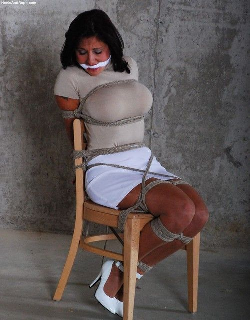 image Candy gets restrained on a chair with leather cuffs