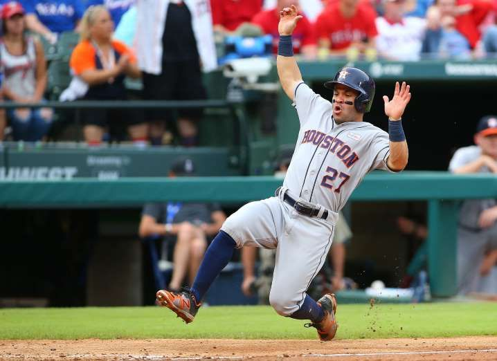 BACK TO BASES: The Astros' Jose Altuve scores against the Rangers on June 3 in Arlington, TX. The Astros won 6-5.