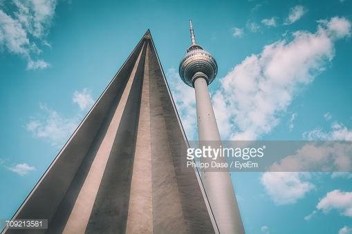 Stock-Foto : Low Angle View Of Fernsehturm By Triangle Shape Against Sky