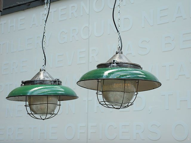 Pair of impressive 1960s prismatic glass pendants with green enameled shades