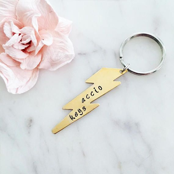 ✢ This Harry Potter inspired keychain is a great gift for yourself or another! Stamped with Accio Keys, this cute keychain is the perfect addition to any keyring!   ✢ Purchase of this item will include ✢ - (1) brass, 2 long lightening bold blank - (1) 24 mm keyring  **Gold keyring available upon request   ✢ How to Personalize Your Item ✢ In notes to seller on the checkout page, include: - Word/quote choice (if changed):   ✢ Classy Crafts by Ash Information ✢ - Each item is 100% handmade ...