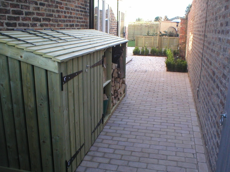 Purpose built log store with integral bin and recycling space at Huby, York
