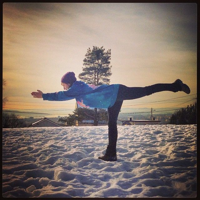 Yoga warrior 3 pose on the snow