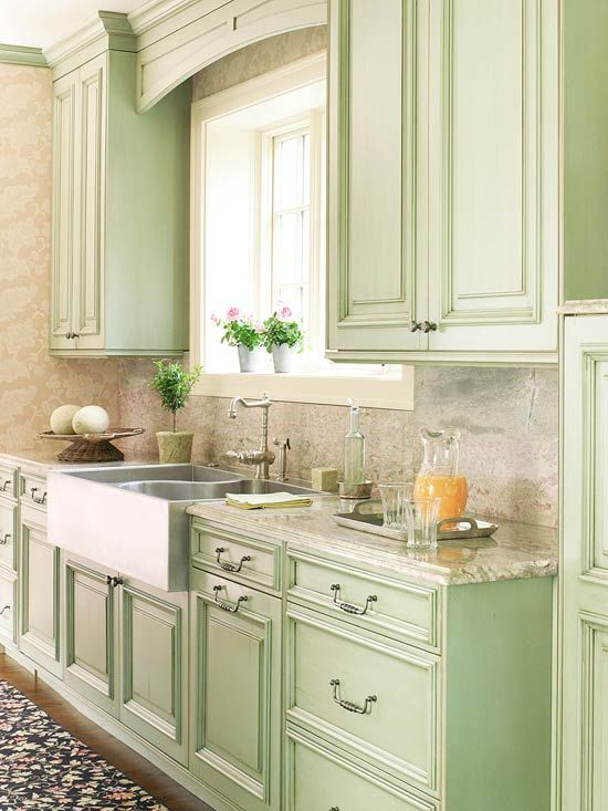 pistachio green cabinets, stainless steel farm-style sink & fixtures, white & grey marble counters