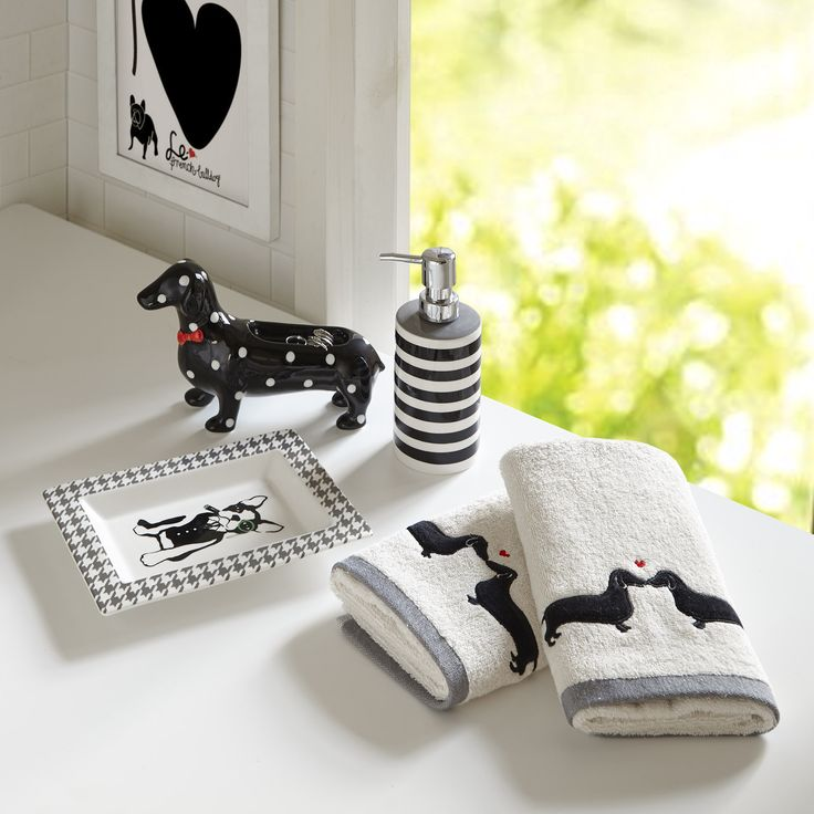 Create an eye-catching look in your bathroom with the HipStyle Hannah Collection. This unique set includes a cabana stripe soap dispenser, dachshund polka dot ring tray and boston terrier herringbone printed accessory tray.