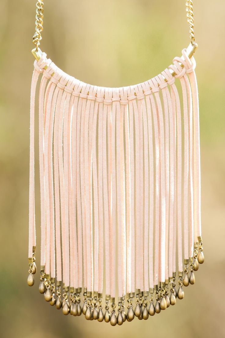 """""""Break Away"""" from safe and mundane jewelry choices and take a chance on something bold. Rock this fringed beauty and you'll be wanting to make a statement (necklace) more often. Bib necklace features an antiqued gold chain and pendant wrapped with faux suede to create fringe. Length measures 16"""" with 3"""" extension."""