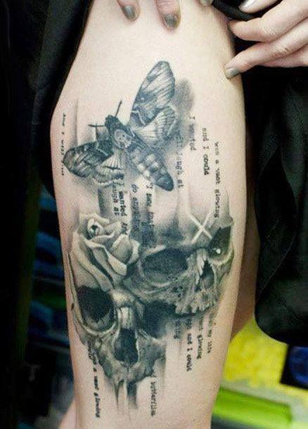 Moth and skull tattoo.