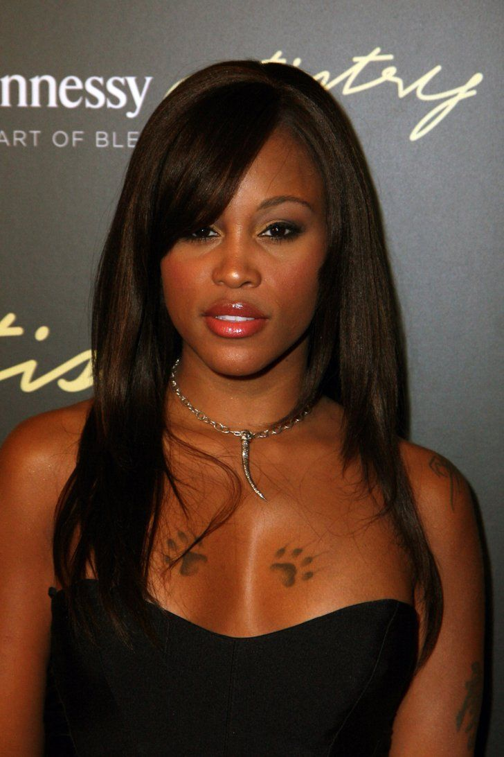 Pin for Later: The Ultimate Celebrity Tattoo Gallery Eve Rapper Eve became known for her breastbone paw prints.