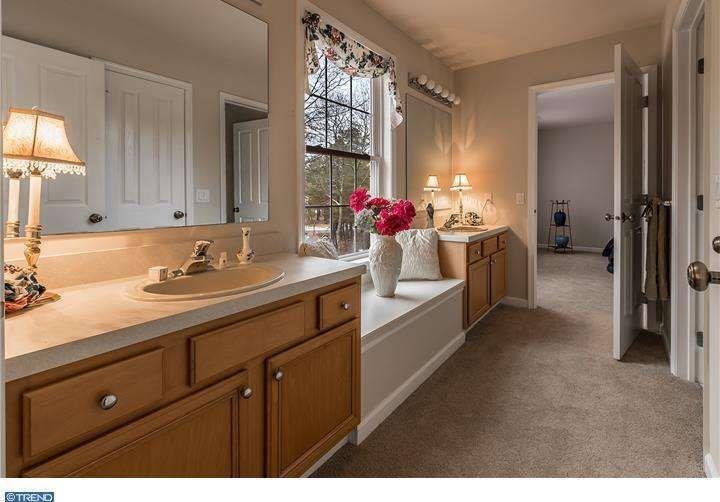 Traditional Full Bathroom with Window seat, Limestone counters, Raised panel, Limestone, simple granite floors, High ceiling