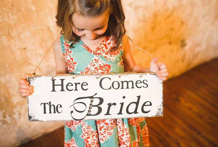 """""""Here comes the bride"""" sign- adorable! // photo by Jennifer Baumann Photography, http://theeverylastdetail.com/2013/10/11/rustic-coral-and-aqua-wedding/"""