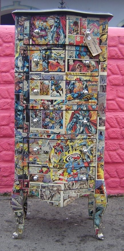 This is awesome! I probably have enough doubles of my favorite comic books to actually pull this off, too… Hmm… a Buffy/Angel/Firefly/X-Men dresser or nightstand for Baby's room, maybe