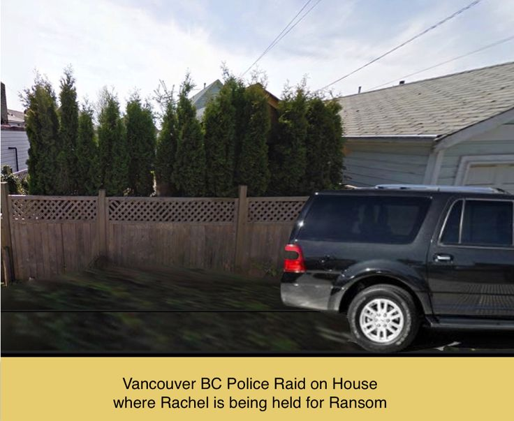 The police car parked in the back alley, outside the house where Rachel is being held for ransom.
