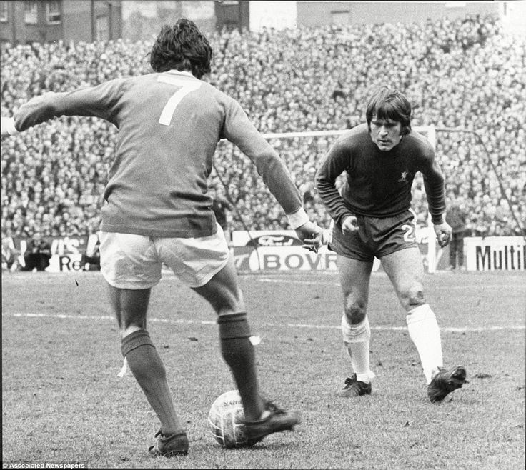 A full house at Stamford Bridge watches on as Best takes on Chelsea's Dave Webb in a first division match in March 1970