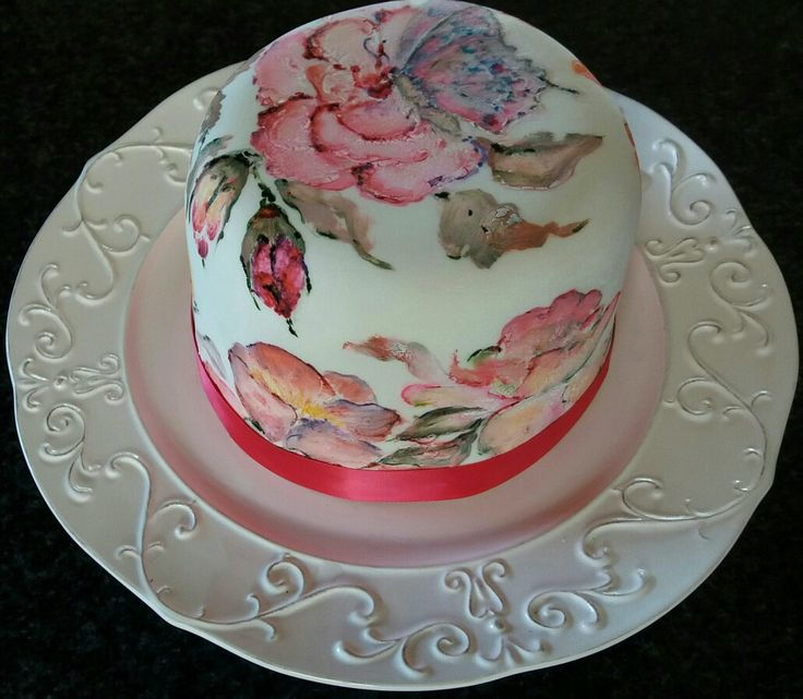 Lovely rich and moist dark fruit cake painted with roses and lisianthus and a butterfly!