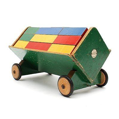 Green painted blocks-wagon, with polychrome painted blocks and with original metal wheels with rubber tires, design Ko Verzuu ca.1935, executed by ADO (Arbeid Door Onvolwaardigen), Berg en Bosch / the Netherlands