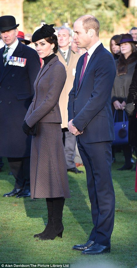 The royal couple watch as the Queen and The Duke of Edinburgh lay wreaths at the War Memorial Cross at Sandringham