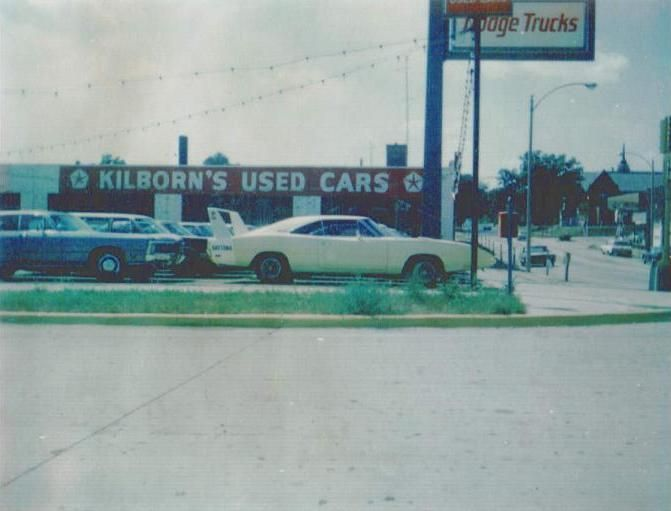 1969 Dodge Charger Daytona on the car lot. They couldn't even give away those winged cars back then!