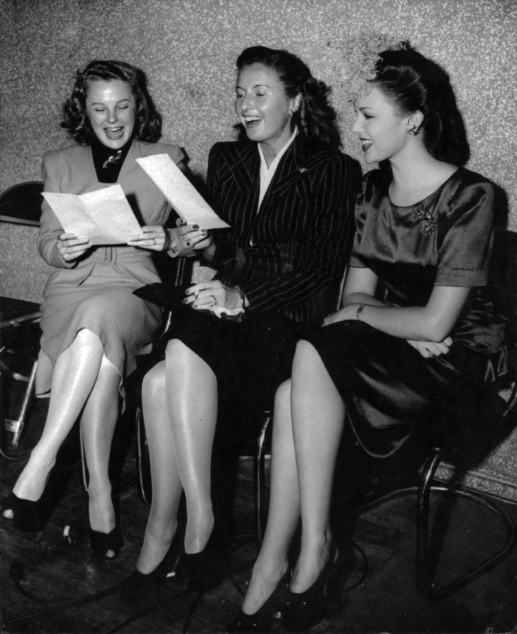 THAT'S FUNNY! - June Allyson, Barbara Stanwyck, and Linda Darnell are amused by the script they are reviewing - Mid-1940s.