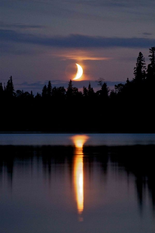 Moon setting on the lake in Garden Hill, Manitoba
