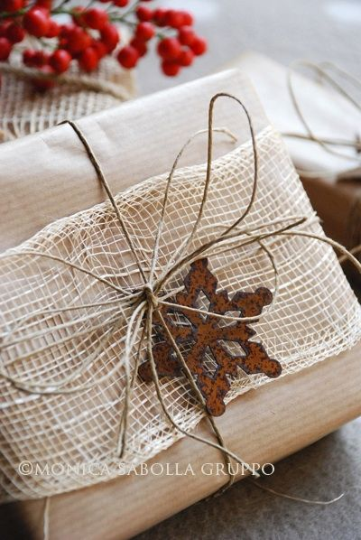 Brown Wrap...with rustic ribbon, twine & rusty snowflake trim.  There are some lovely rustic holiday wrapping ideas on this site.