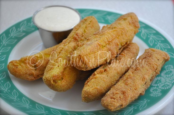 Fried Pickles 1 jar dill pickle spears 1 cup flour ½ cup plain yellow corn meal 1 tablespoon seasoned salt 1 cup milk Vegetable Oil to cook in Ranch Dressing for dipping