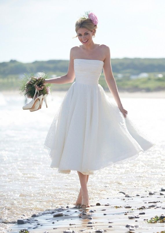 How i love this refined strapless wedding dress, beacause it is more simple but beautiful --------strapless simple tea-length beach wedding dress