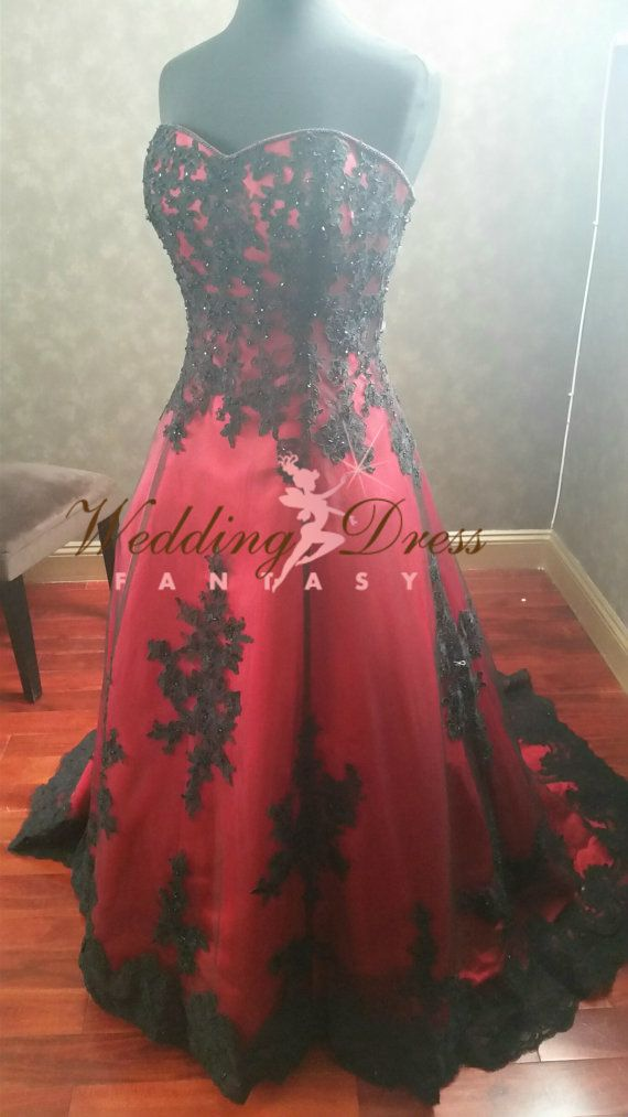 Gorgeous Red and Black Wedding Dress from Weddingdressfantasy.  If youre looking for an elegant Wedding Gown that is unique, you will