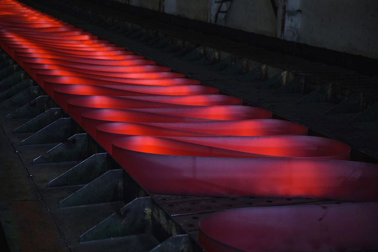 Red hot rolled steel on the production line at Zhong Tian Steel Group on May 13, 2016 in Changzhou, China.