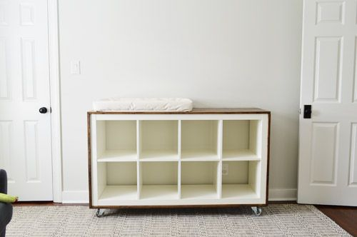 Ikea expedit hack - cover with stained wood and add casters. Might do this with our existing shelf for record storage?