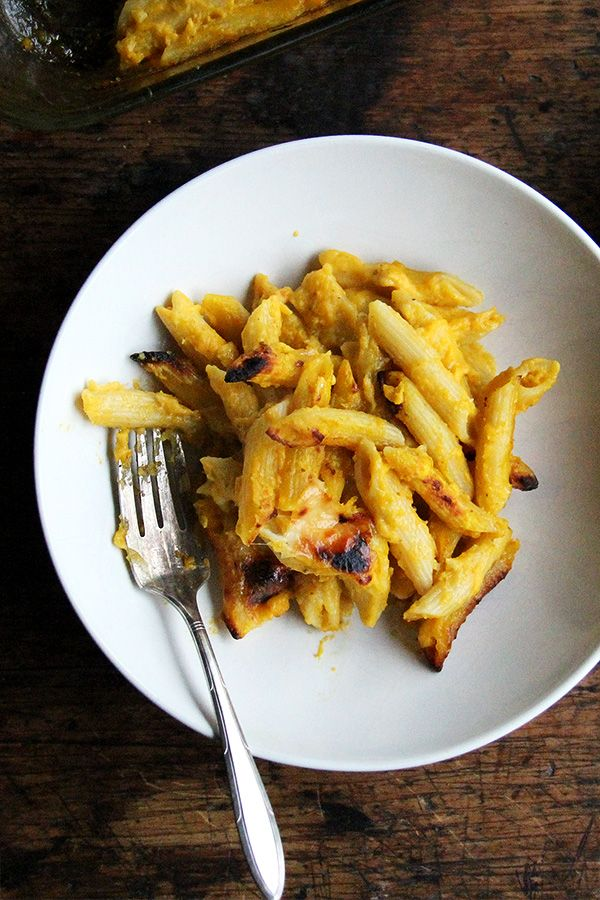 Baked Penne with Butternut Squash-Sage Sauce // It's an adaptation of a long-time favorite butternut squash-sage sauce, which I typically toss with rotini (or other pasta) and serve with parmesan. Here, the par-cooked pasta is tossed with the sauce and a mix of mozzarella and parmesan, then baked in a hot oven until the the tips are crispy and the cheese has melted. It's delicious. @alexandracooks