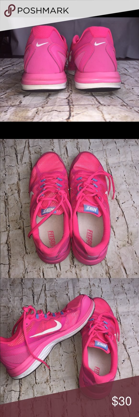 Women's Nike Dual Fusion Sneakers Beautiful pink Women's Nike dual fusion sneakers. Size 10. Does show little signs of wear but in overall good shape. Perfect for athletic use or everyday wear. Nike Shoes Athletic Shoes