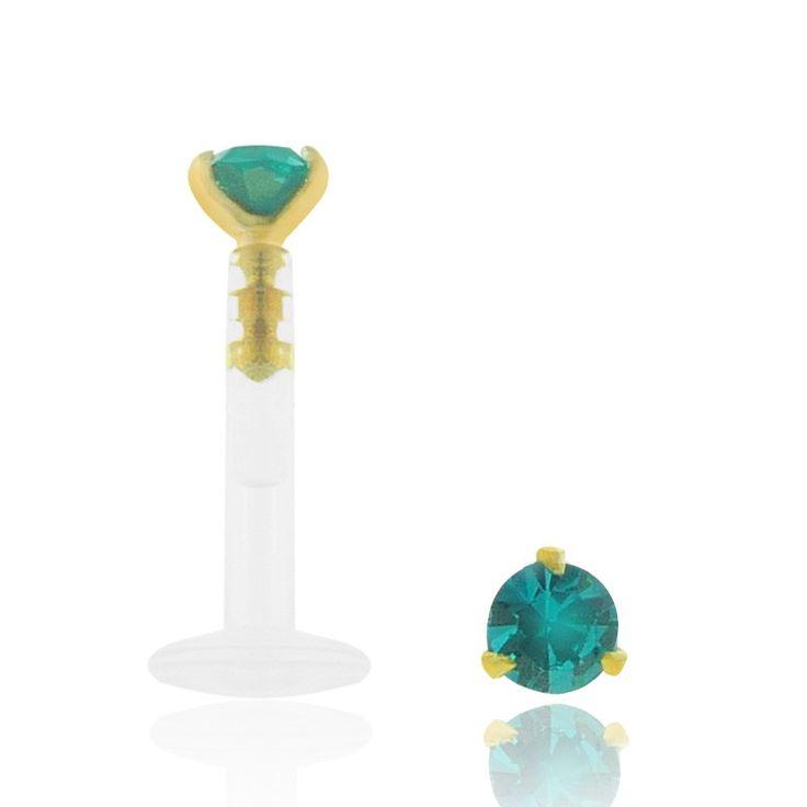 Piercing de bouche, de tragus et de cartilage de l'oreille (hélix) en or jaune 18 carats avec un oxyde de zirconium turquoise griffé.