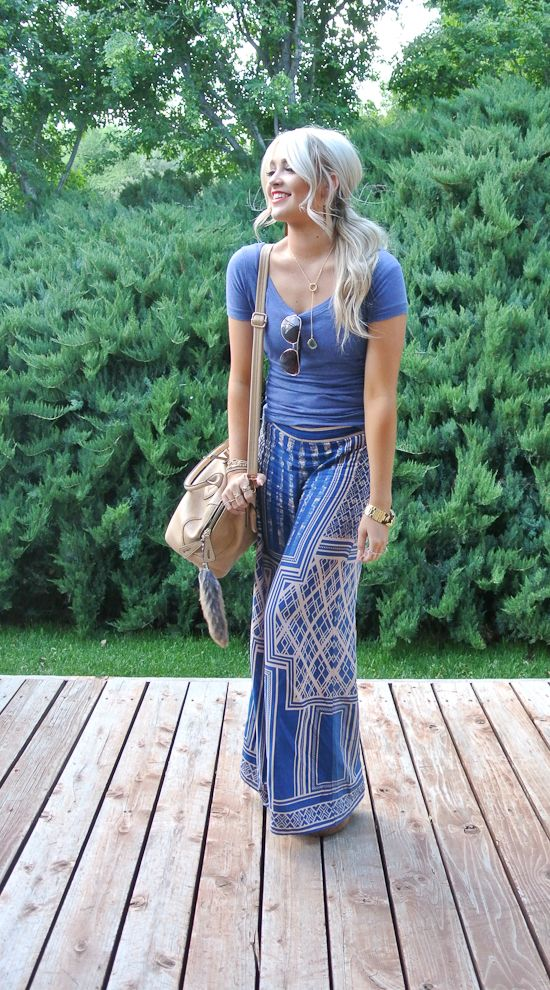 Cara Loren absolutely babe'n in 70s style Koo De Ker pants, basic tee and excellent accessories. Such great hair as always. Hot!