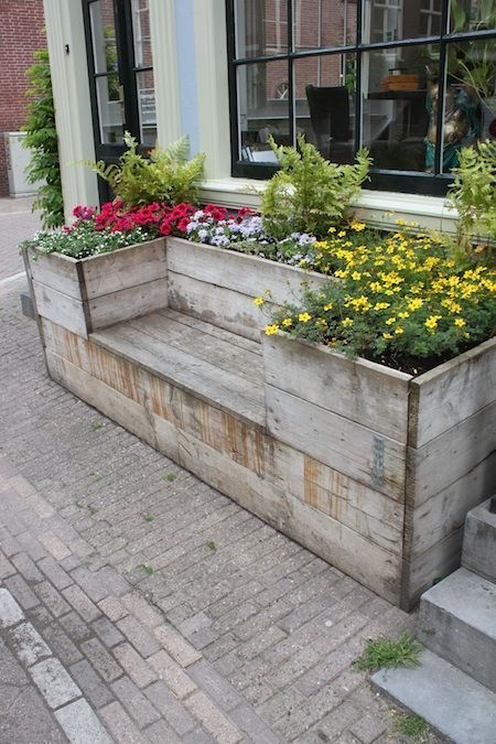 Wooden gardening box with a built-in bench