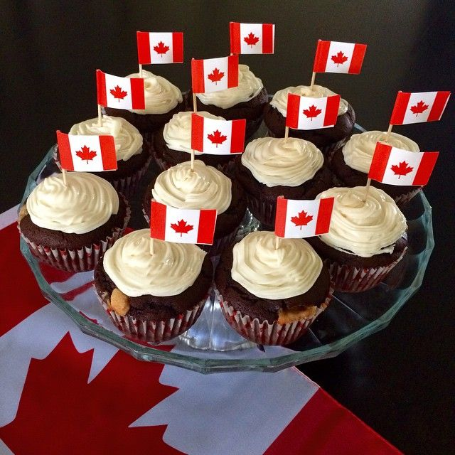 Happy Canada Day!  Preparing for tonight's BBQ. The chocolate peanut butter cupcakes are done! #canadadayinthenookeh @zimmysnook
