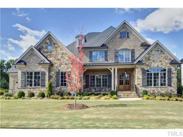 All Brick Stone Exterior With Double Door Entry At Front Porch Home Has A