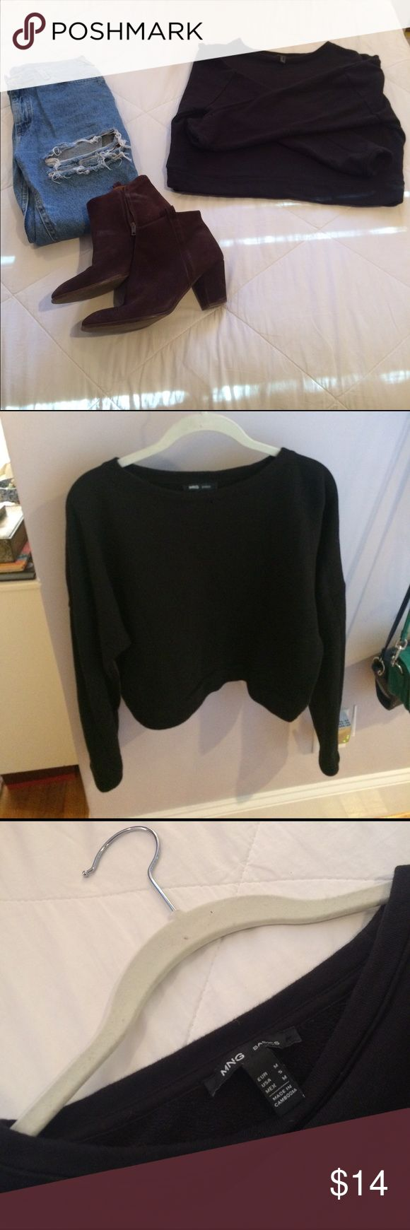 Cute cropped black sweatshirt MNG by Mango very cute basic black sweatshirt by MNG for Mango. can be dresses up or down. Very versatile. 6in ruler shown in 5th picture. About 18 in long from shoulder. Size medium. Shirt stops right below belly button. Worn once before, in great condition. only sweatshirt included. MNG by Mango Tops Sweatshirts & Hoodies