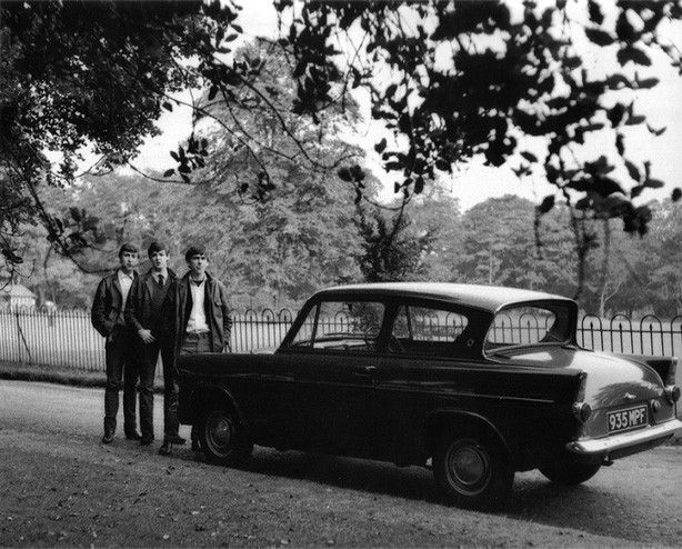 John,Paul & George pose with George's first car, a 1955 Ford Anglia in 1962