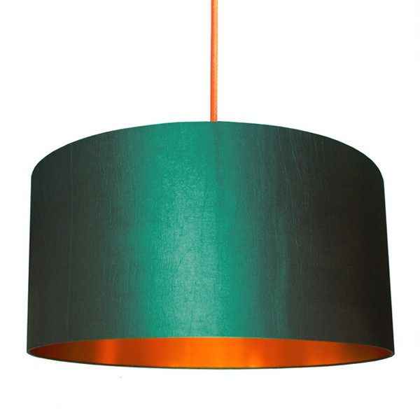 Add some designer flair to your abode with the Fabric Lampshade – Peacock & Brushed Copper!  This sumptuous drum lampshade in peacock green would make a splendid accent piece for a house or flat decorated in minimalist, contemporary, modern or Scandinavian style, among others. It features a slightly warped textile overlay that shrouds layers of flame retardant PVC made to look like sheets of brushed copper to harness and radiate all of the light. None of it will tri