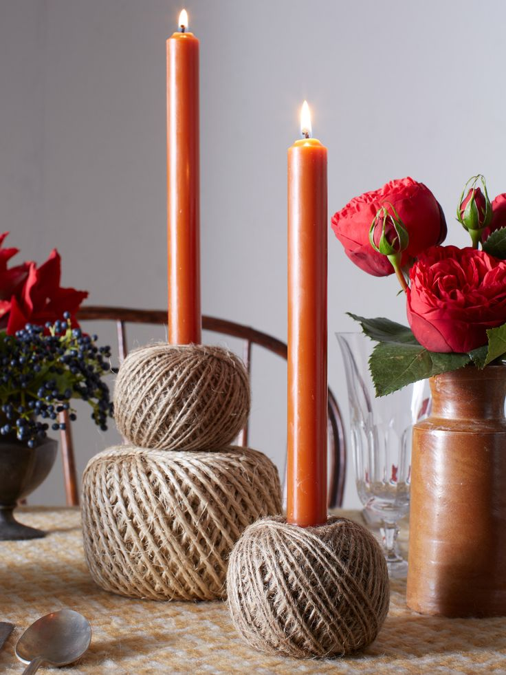 How-to: Make your own quick and easy rustic candleholders by simply stacking balls of twine and inserting the candle. Voilà!