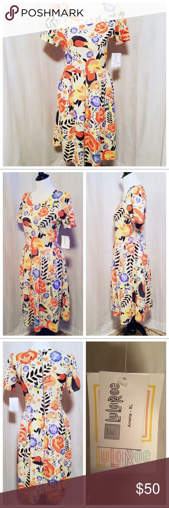 NWT ~ LuLaRoe Amelia Dress - Size XL (14-16) NWT! Yellow Multi- Color Tropical Bird Print Amelia Dress from LuLaRoe * Fit & Flare, Reach -In Side Pockets on Skirt * Zipper up Back * Midi Length * Size XL (14-16) LuLaRoe Dresses Midi
