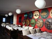 Restaurante Bodega el Riojano de Santander. En el centro centro.. Una excelente cocina y la posibilidad de degustarla en un entorno cultural y artistico. Una importante coleccion de obras de arte contemporaneas que constituyen uno de los museos mas sorprendentes. El museo Redondo