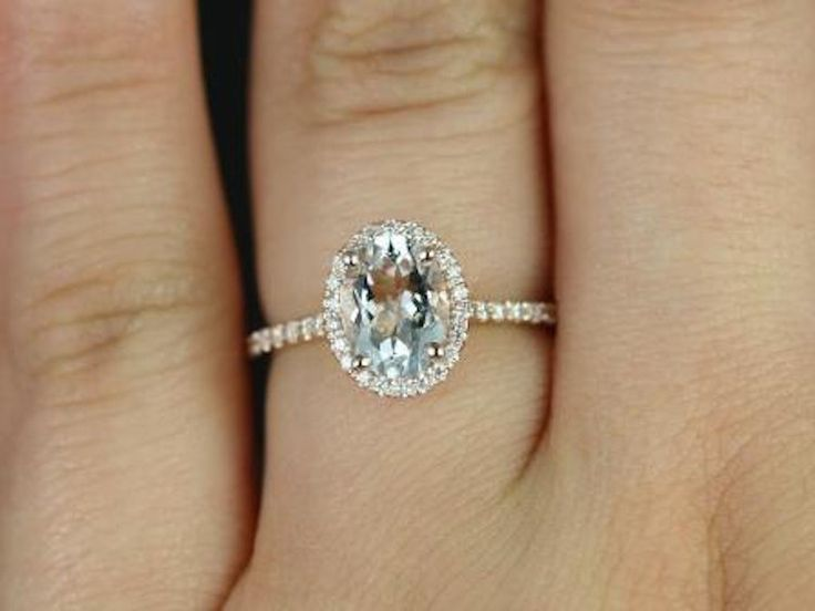 Rose_gold_and_white_sapphire_oval_cut_engagement_ring.full