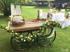 Unique Wedding Ideas - Wheelbarrow at the Wedding | Wheelbarrow decorated with floral trails, basket of photo booth props and eiffel tower hookah! #wedmegood #decor #wheelbarrow