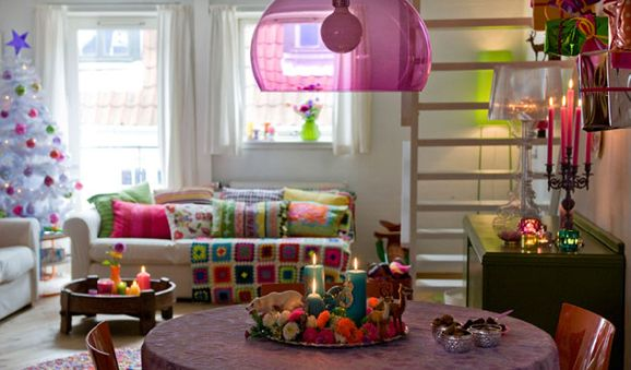 Love the sofa pillows and pink and green hues