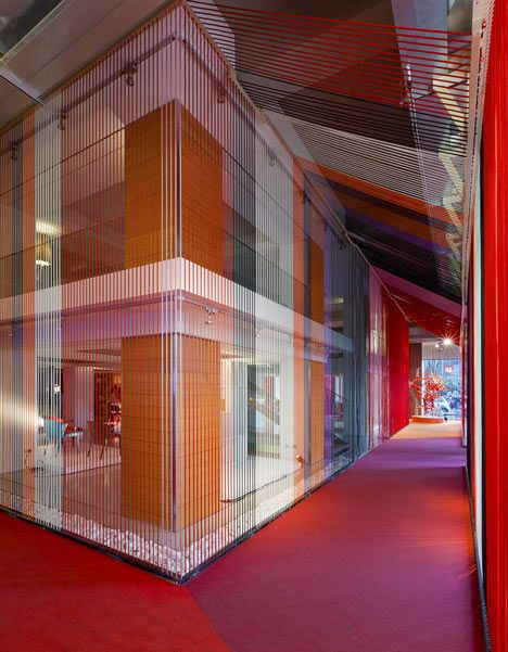 Calligaris offices in Milano, filled with colourful ropes, Installation by Designer Stephen Burks