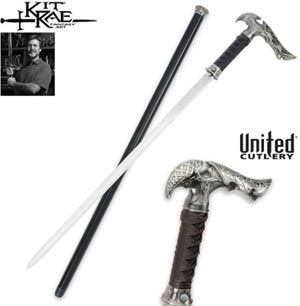 Kit Rae Axios Sword Canes for sale are made by United Cutlery. This sword cane offers beautiful details. The sharpened 1045 high carbon steel  blade is 23 inches in all. The Kit Rae Axios Sword Canes have a hardwood cane shaft that is painted black with coordinating accents. The popular Axios Sword Canes have rayskin and leather wrappings on the handle and measure 39 inches in all. The blade of the Axios Sword Canes is released through a quick blade-release mechanism.